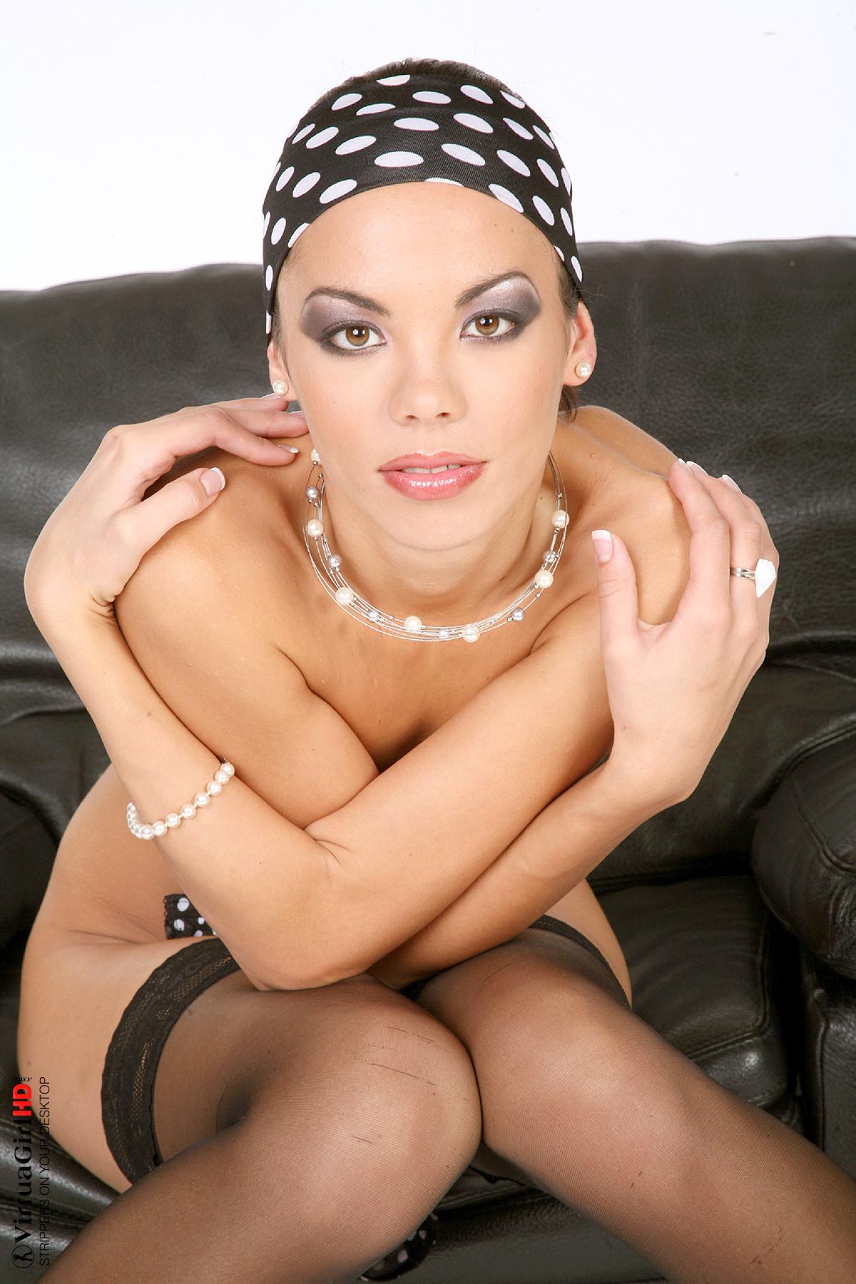 glamorous schoolgirl in sexy striptease